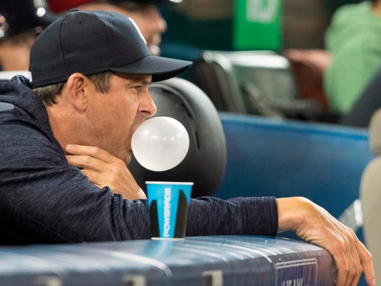 New York Yankees manager Aaron Boone blows bubble with gum in the sixth inning.