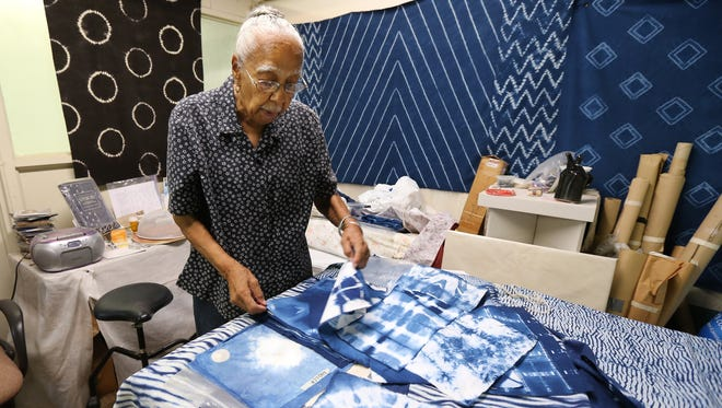 Elmer Lucille Allen looks over small samples of textile art created using the Shibori method of dying fabric.  Allen was recently awarded the Kentucky Museum of Art and Craft's first Art and Advocacy Award.  She has been a long-time leader in the African-American community and in the arts community. October 8, 2015