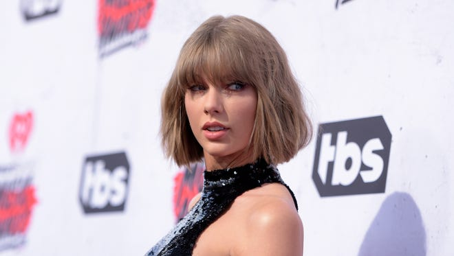 In this April 3, 2016 file photo, Taylor Swift arrives at the iHeartRadio Music Awards at The Forum in Inglewood, Calif.