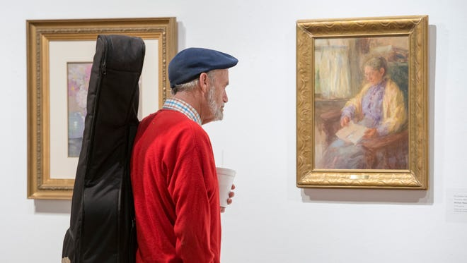 """Kent Stanton checks out the """"Rebels With A Cause: American Impressionist Women"""" exhibit at the Pensacola Museum of Art on Wednesday, November 15, 2017."""