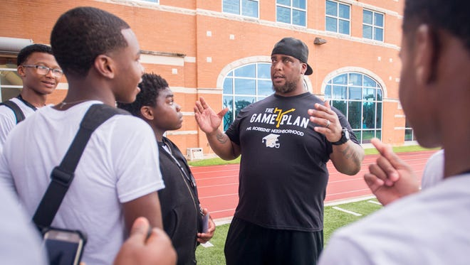 Fred Robbins talks with the participants of his annual football skills and career development camp at the Exos training facility at the Andrews Institute in Gulf Breeze on Wednesday, June 13, 2018.