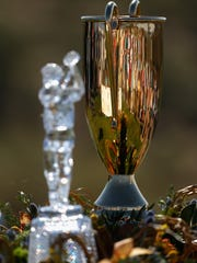 The Charles Schwab Cup Championship trophy and the