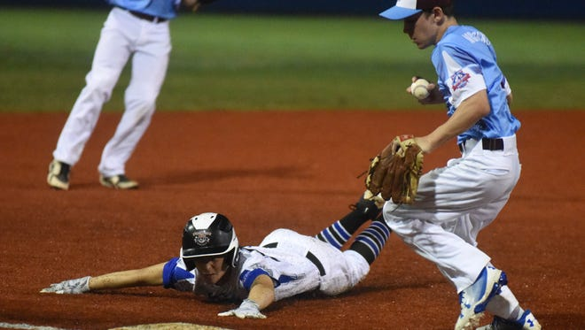 Mountain Home's Dillon Drewry slides into third base as Jay McDonnell of Broomall-Newtown, Penn., runs to the bag during the Middle Atlantic Regional champion's 8-5 victory over the hosts Monday night.
