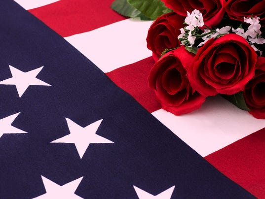 Bouquet of roses on American flag - close up