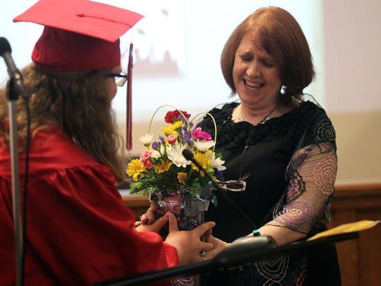 636312490455581155-170524-06-Transitions-graduation-ds.jpg