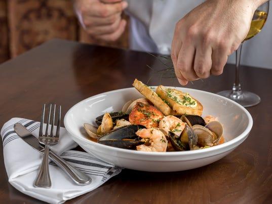 636504989078822492-Salmon-Bouillabaisse-with-chef.jpg
