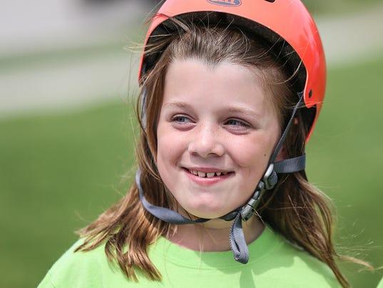 Bella Cates receives bike from Rose Hulman