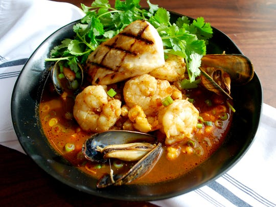 Posole del Mar is loaded with market fish, mussels, shrimp and hominy with chilies and cilantro at the 404 Kitchen in the Gulch.
