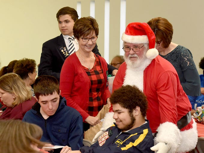 Santa arrives bringing gifts to the annual Opelousas