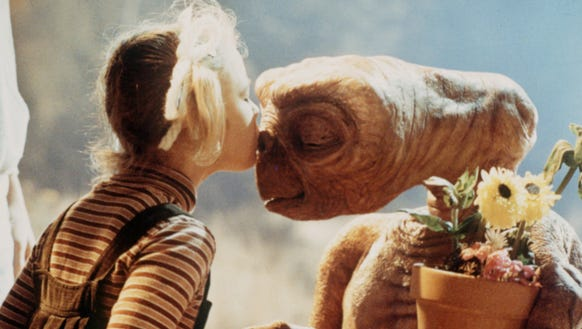Gertie (Drew Barrymore) smooches E.T. in a classic