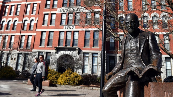 Jonas Clark Hall at Clark University in Worcester. At right is statue of Sigmund Freud, who spoke at the school in 1909.