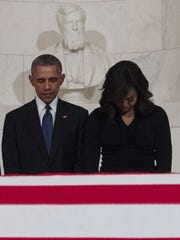 President Obama and first lady Michelle Obama pay their respects as Justice Antonin Scalia's body lies in repose at the Supreme Court on Feb. 19, 2016.