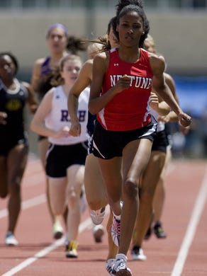 Shore Conference Track & Field Spring Championship takes place at Neptune High School on Saturday, May 15, 2010. Neptune's Ajee Wilson takes first in the 800m.  Doug Hood/ Asbury Park Press- Neptune, NJ- 05.15.10 (#87671)