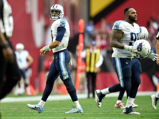 Titans quarterback Marcus Mariota (8) walks off the