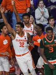 Clemson forward Donte Grantham (32) celebrates making a three-point shot against Miami during the second half at Littlejohn Coliseum in Clemson on Saturday.