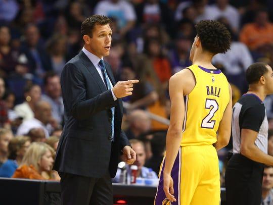 Los Angeles Lakers head coach Luke Walton talks to
