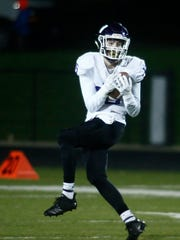 Waukee junior Sam O'Dell is wide open on a long touchdown pass. Indianola hosted Waukee on Oct. 12.