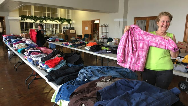 Jan Nowak holds a child's coat, part of Pontifex's annual fall rummage sale. The sale will be from 9 a.m. to 5 p.m. Friday and from 9 a.m. to 3 p.m. Saturday with a $1 bag sale starting at noon. Pontifex is located at 416 W. State St. in Fremont.