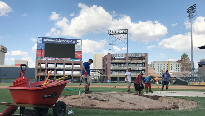 Members of the El Paso Chihuahuas ground crew in September begin taking apart the removable mound at Southwest University Park in preparation for October events. The removable mound is one of five in all of baseball.