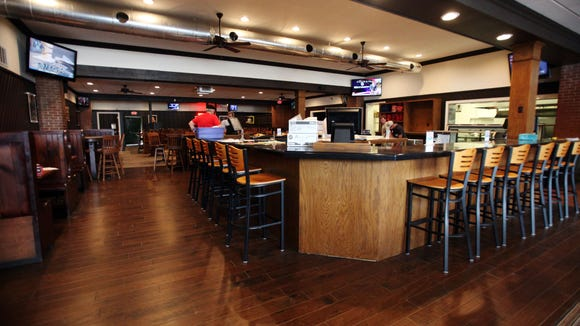 A new bar, floors and other furnishings are seen Tuesday, May 19, 2015, at Pete's in Lafayette, La.