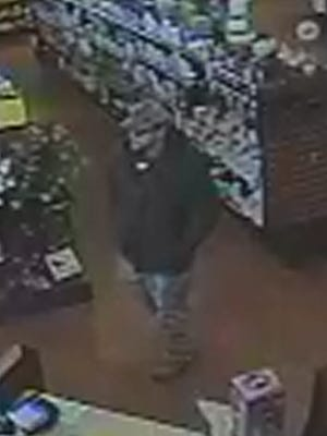 Pennsylvania State Police are seeking this man in connection with a pharmacy robbery in Red Lion on Wednesday, Feb. 24, 2016.