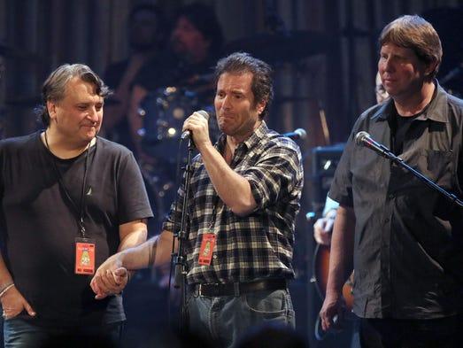 Bob Benjamin (center) becomes emotional as he speaks