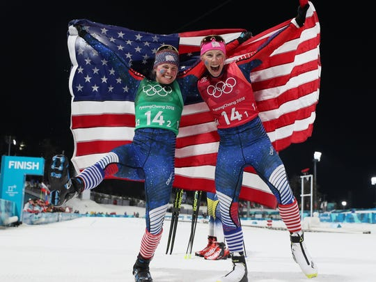 Jessica Diggins (USA) and Kikkan Randall (USA) celebrate winning the gold medal in the ladies' cross-country skiing team sprint freestyle final during the Pyeongchang 2018 Olympic Winter Games at Alpensia Cross-Country Centre. Mandatory Credit: Soobum Im-USA TODAY Sports