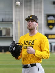 Iowa pitcher Nick Allgeyer poses for a photo before