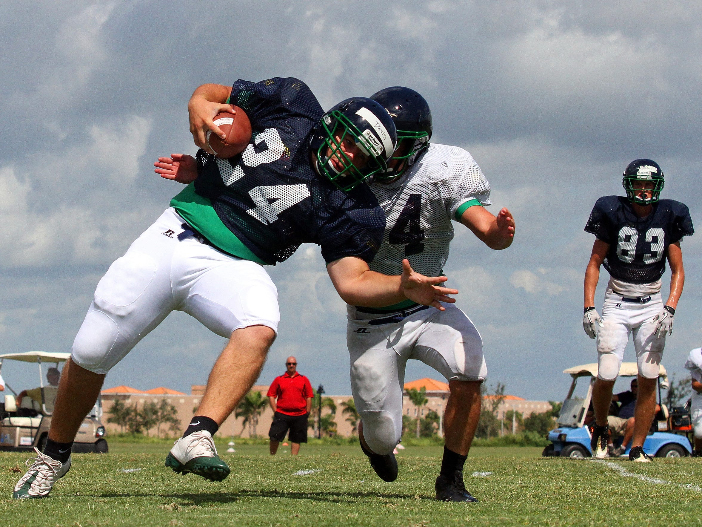 Ave Maria running back Stefan Davis tries to elude the tackle of cornerback Blake Heiman during practice at Ave Maria University in 2011.