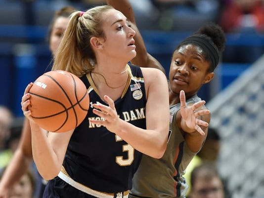 Notre Dame's Marina Mabrey, left, is guarded by Connecticut's Crystal Dangerfield during the first half an NCAA college basketball game, Sunday, Dec. 3, 2017, in Hartford, Conn. (AP Photo/Jessica Hill)