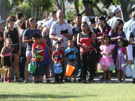 Children get ready to run toward Easter eggs during the annual Palm Springs Firemen's Association Easter egg hunt at Ruth Hardy Park in Palm Springs on Saturday.