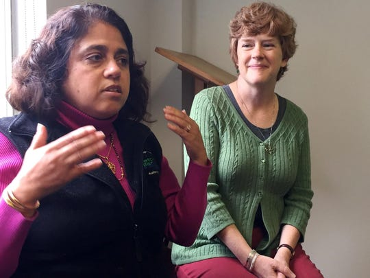 Lakshmi Joshi Boyle, left, a speech and language pathologist at University of Vermont Medical Center, describes therapies used to help the Rev. Karen Mendes, right, cope with chemo brain.