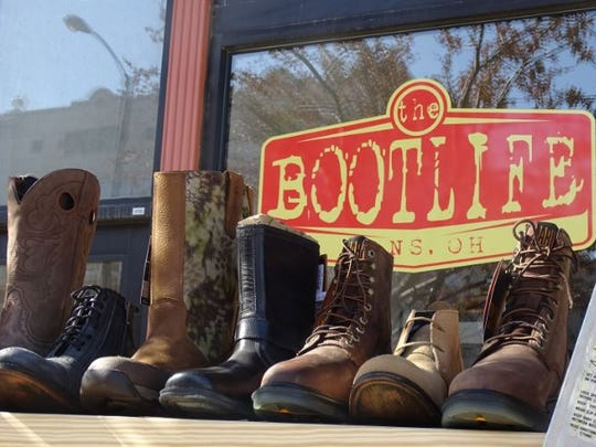 Country boots, work boots and fashion boots for men, women and children all are on display at The Boot Life on West Fourth Street.