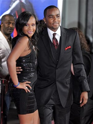 """Bobbi Kristina Brown and Nick Gordon attend the Los Angeles premiere of the Whitney Houston movie """"Sparkle"""" at Grauman's Chinese Theatre in Los Angeles in 2012. Houston raised the two together after her divorce from Bobby Brown. They announced a romantic relationship after her death. Bobbi Kristina has been in a coma for months but is now awake, her father says."""