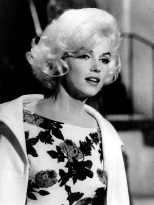 """FILE - This April 1962 file photo shows actress Marilyn Monroe on the set of her last movie, """"Something's Got To Give,"""" in Los Angeles.  Officials say a dress worn by Monroe as she famously sang """"Happy Birthday"""" to President John. F. Kennedy has sold for nearly $5 million at a Los Angeles auction. Julien's Auctions says that the iconic, form-fitting gown was sold for $4.8 million Thursday, Nov. 18, 2016 to Ripley's Believe It or Not."""