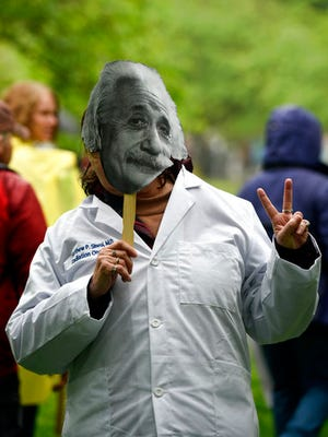Ellen Taylor from Albany, N.Y., poses with an Albert Einstein mask for a portrait at the March for Science event in Washington, Saturday, April 22, 2017.