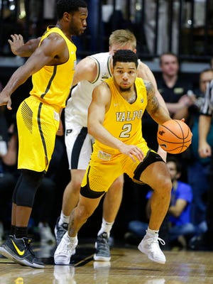 Valparaiso guard Tevonn Walker (2) heads up court against Purdue in the first half of an NCAA college basketball game in West Lafayette, Ind., Thursday, Dec. 7, 2017. (AP Photo/Michael Conroy)