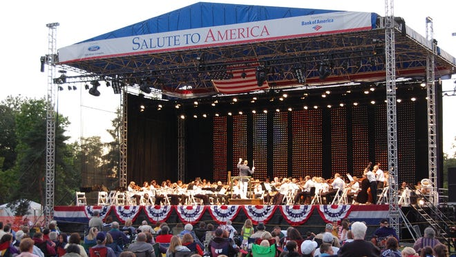 """The Detroit Symphony Orchestra performs outdoors during the annual """"Salute to America""""  concerts at Greenfield Village."""