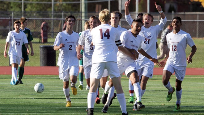 The Morristown boys soccer team celebrates a goal during the 1st half of the NJSIAA North 1 Group IV boys soccer semifinal game against Morris Knolls last November. 2014.