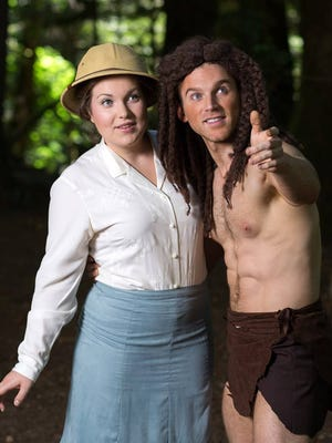 Tarzan (Jimmi Cook) shows his new friend Jane (Sarah Fairchild) around his jungle home.