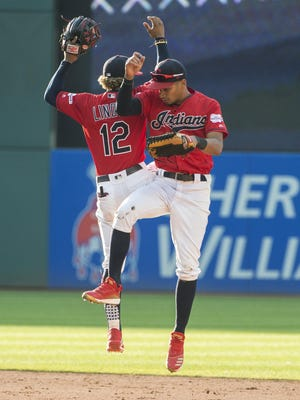 The Indians' Oscar Mercado celebrates with Francisco Lindor after the Indians' 5-1 win over the Texas Rangers in the second game of a doubleheader last season.