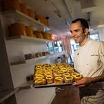 Chef Dominique Ansel holds a tray of Cronuts on June 10, 2013, in New York City. The bakery has been temporarily shut down by the Department of Health for a mouse infestation.