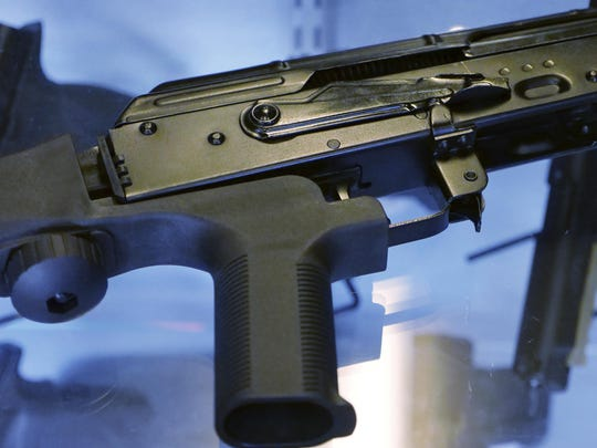 "A device called a ""bump stock"" is attached to a semi-automatic rifle at the Gun Vault store and shooting range in South Jordan, Utah."