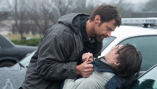 Hugh Jackman, left, confronts Paul Dano in 'Prisoners.'