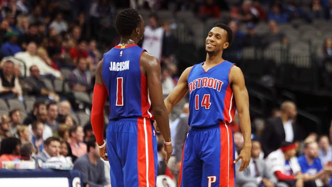 Dec 14, 2016; Dallas, TX, USA; Pistons guard Reggie Jackson laughs with Ish Smith  during the second half against the Dallas Mavericks at American Airlines Center.