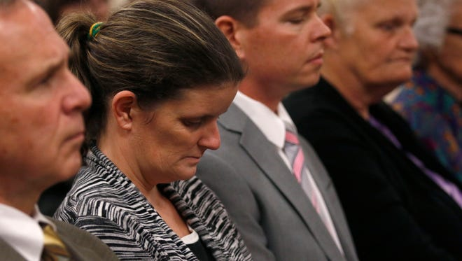 Stacey Herman, Hailey Owens mother, looks downward after the jury could not come to a unanimous decision Monday on whether Craig Wood, the man who killed her daughter in 2014, should be sentenced to death.