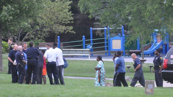 North Shore Fire and Shorewood Police officials meet with family members of the 14-year-old boy who drowned near Atwater Beach around 6 p.m. on Tuesday, July 18.
