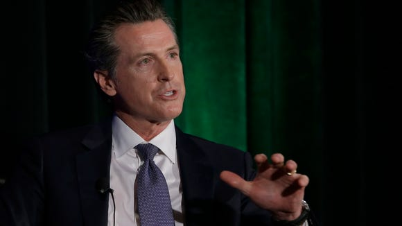 California gubernatorial candidate Lt. Gov. Gavin Newsom, a Democrat, discusses the state's housing problems at a conference on March 8, 2018, in Sacramento.