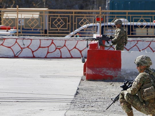 Soldiers from 6th Squadron, 1st Cavalry Regiment pull