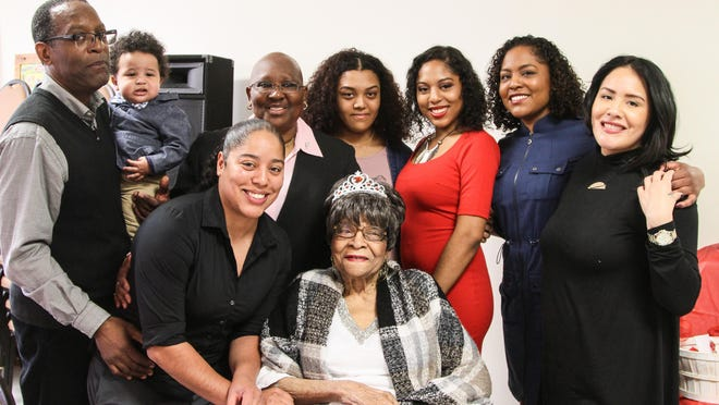 Lucy Gholson celebrates her 100th birthday surrounds by her grandchildren, great grandchildren, and great great grandchildren at Union Baptist Church in Morristown March 19, 2016. Alexandra Pais/ For The Daily Record